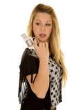 Woman black star shirt gun look back Stock Photography