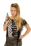 Woman black star shirt gun point up stock photo