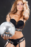 Woman in black stockings with disco ball Royalty Free Stock Images