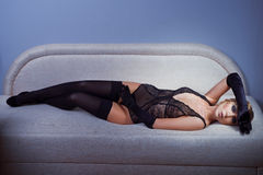 Woman in black stockings Stock Images