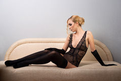 Woman in black stockings Stock Photo