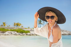 Woman with black summer hat on the beach Royalty Free Stock Photos