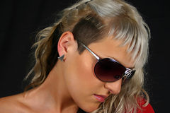 Woman in black sunglasses. Side portrait of trendy young woman with dyed blond hair in dark sunglasses Royalty Free Stock Photos