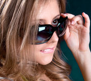 Woman  with black sunglasses is bite a lips Royalty Free Stock Images