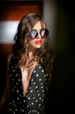 Woman with black sunglasses  and long curly hair. Beautiful woman portrait. Fashion art photo of young model with sunglasses Royalty Free Stock Photos
