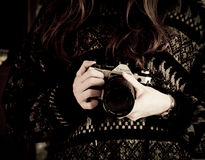Woman in Black Sweater Holding White and Black Canon Dslr Camera Royalty Free Stock Photography