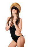 Woman in black swimsuit biting pearls Stock Images