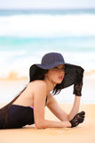 Woman in Black Swimsuit, Hat, and Gloves at the Be Royalty Free Stock Photos