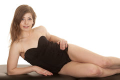 Woman black swimsuit lay side look Stock Images