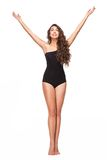 Woman in black swimsuit raising hands up Royalty Free Stock Images
