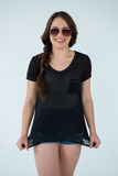 Woman in black t-shirt and hot pants Stock Image