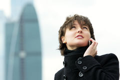 Woman in black talking on mobile Royalty Free Stock Photos