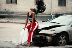 Woman in Black Tank Top Sitting in Front of Car stock images