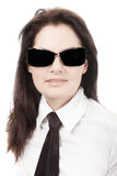 Woman in black tie and glasses Stock Images