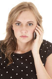 Woman black top dots phone mad Royalty Free Stock Image