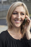 Woman in Black Top Talking on Cell Phone Royalty Free Stock Photography
