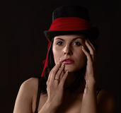Woman in black tophat with red shawl Stock Image