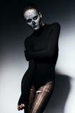 Woman in black torn pantyhose. In studio Stock Photos