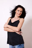 A woman in a black undershirt with tousled hair Royalty Free Stock Photography