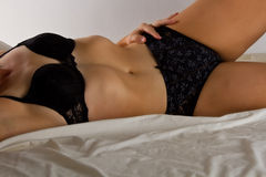 Woman in black underwear lay on bed Royalty Free Stock Photo