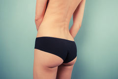 Woman in black underwear touching herself Stock Photography