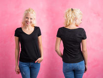 Woman in black V-neck T-shirt on pink background. Front and back Royalty Free Stock Images