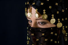 Woman in black veil. Mysterious eastern woman in black veil looking ahead Royalty Free Stock Photography