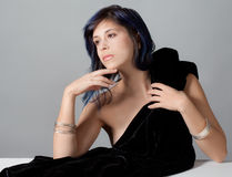 Woman With Black Velvet Fabric Stock Photo