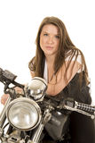 Woman black vest motorcycle facing serious close Royalty Free Stock Images
