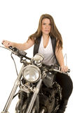 Woman black vest motorcycle facing serious Stock Image