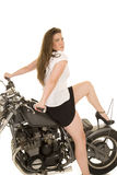 Woman black vest motorcycle sit back heal up Stock Image