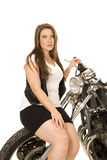 Woman black vest motorcycle sit on front tire Royalty Free Stock Images