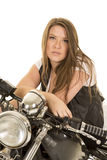 Woman black vest motorcycle sit serious Royalty Free Stock Photos