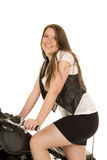 Woman black vest motorcycle skirt stand smile Stock Images