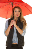 Woman in black vest and red umbrella funny expression Stock Images