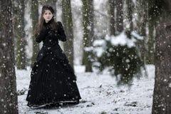Woman in black Victorian dress Stock Photo