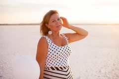 Portrait of Woman with balloon on salt lake in Larnaca, Cyprus royalty free stock images
