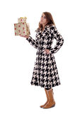 Woman in black & white coat with xmas presents Stock Images