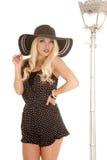 Woman black white dots hat lamp serious Royalty Free Stock Photos