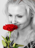Woman in black and white and a red rose Royalty Free Stock Photography