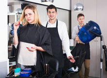 Woman blaming hairdresser in bad haircut Royalty Free Stock Photos