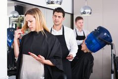 Woman blaming hairdresser in bad haircut Stock Image
