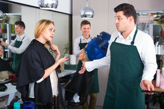 Woman blaming hairdresser in bad haircut Royalty Free Stock Images