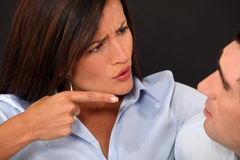 Woman blaming her husband. For something Stock Photo