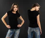 Woman with blank black shirt over black background. Photo of a beautiful brunette woman with blank black shirt over black background. Ready for your design or Stock Images