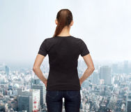 Woman in blank black t-shirt Royalty Free Stock Images