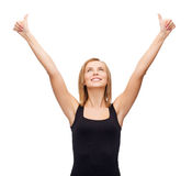 Woman in blank black tank top showing thumbs up. T-shirt design, happy people concept - smiling woman in blank black tank top showing thumbs up Stock Photography