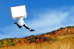 Woman with blank board at autumn day Royalty Free Stock Photography