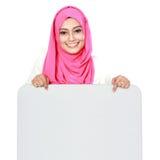 Woman with blank board. Portrait of woman wearing scarf showing blank board Stock Photo