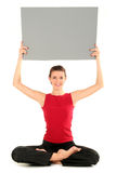Woman with blank card. Doing yoga Royalty Free Stock Photos